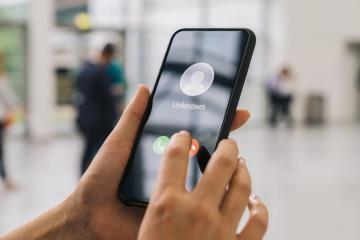 Unknown number calling in the ctiy. Phone call from stranger. Person holding mobile and smartphone at a trade fair. Unexpected call disturbs at business conference.- Stock Photo or Stock Video of rcfotostock | RC-Photo-Stock