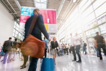 unrecognizable business people walking at a trade fair- Stock Photo or Stock Video of rcfotostock | RC-Photo-Stock