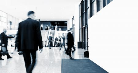 unrecognizable business people walking at a trade show with banner - Stock Photo or Stock Video of rcfotostock | RC-Photo-Stock