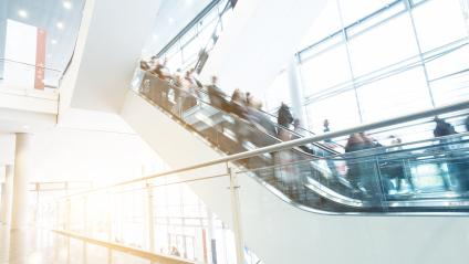 unrecognizable people at escalators on a tradeshow- Stock Photo or Stock Video of rcfotostock | RC-Photo-Stock