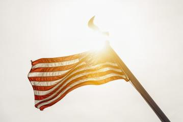 USA flag is waving against sunset sky. United States of America symbol - Stock Photo or Stock Video of rcfotostock | RC-Photo-Stock
