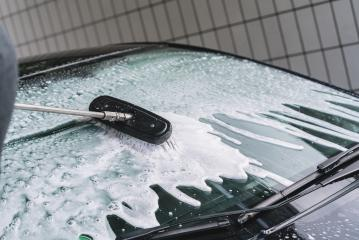 Using a brush to wash a car on a car washing facility on sunny summer day  : Stock Photo or Stock Video Download rcfotostock photos, images and assets rcfotostock | RC-Photo-Stock.: