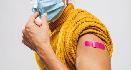 Vaccinated Woman Showing Arm With Pnk Plaster Bandage Protection would like to takes off Face Mask, After Covid-19 Vaccine Injection Posing Gray Background, Coronavirus Vaccination, copy space : Stock Photo or Stock Video Download rcfotostock photos, images and assets rcfotostock | RC-Photo-Stock.: