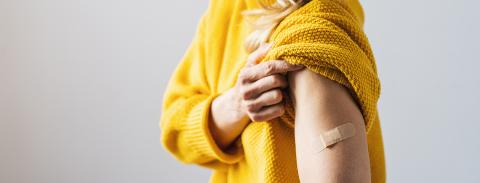 vaccine injection for corona COVID-19 and SARS cov. Woman holding up her sweater sleeve and showing her arm with Adhesive bandage Plaster after receiving vaccination, copyspace for text, banner size : Stock Photo or Stock Video Download rcfotostock photos, images and assets rcfotostock | RC-Photo-Stock.: