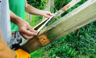 versatile craftsman working with wood to build a house on a summer day, DIY concept- Stock Photo or Stock Video of rcfotostock | RC-Photo-Stock