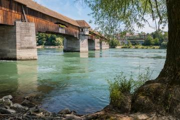 View of the oldest wooden historic border bridge over Rhine river and view to Switzerland in Bad Saeckingen at summer, Black Forest, Baden-Wurttemberg, Germany, Europe- Stock Photo or Stock Video of rcfotostock | RC-Photo-Stock