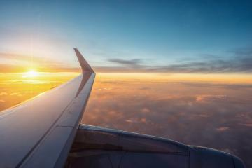 View of the sunset,clouds and airplane wing from the Inside- Stock Photo or Stock Video of rcfotostock | RC-Photo-Stock