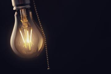 Vintage hanging light bulb with switch over dark background : Stock Photo or Stock Video Download rcfotostock photos, images and assets rcfotostock | RC-Photo-Stock.:
