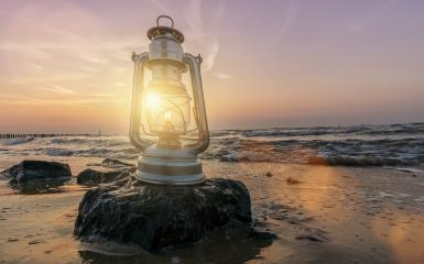 vintage lantern on stone at sunset, romantic evening at the beach- Stock Photo or Stock Video of rcfotostock | RC-Photo-Stock