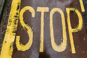 Vintage stop sign on city asphalt floor- Stock Photo or Stock Video of rcfotostock | RC-Photo-Stock