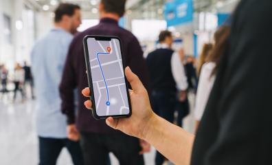 Visitor using GPS map navigation app on smartphone screen to get direction to destination address in the city, travel and technology concept image- Stock Photo or Stock Video of rcfotostock | RC-Photo-Stock