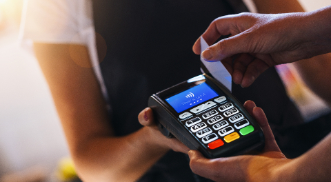 Waiter holding credit card swipe machine while customer swiping card. Woman making payment in cafeteria with credit card. Customer paying for coffee and brunch by credit card reader.- Stock Photo or Stock Video of rcfotostock | RC-Photo-Stock