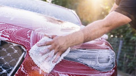 washing red car front with sponge on a car wash- Stock Photo or Stock Video of rcfotostock | RC-Photo-Stock