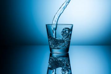 water flows in to a glass : Stock Photo or Stock Video Download rcfotostock photos, images and assets rcfotostock | RC-Photo-Stock.: