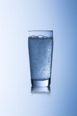 Water glass with sparkling carbonated on blue background with reflex drink drinking water- Stock Photo or Stock Video of rcfotostock | RC-Photo-Stock