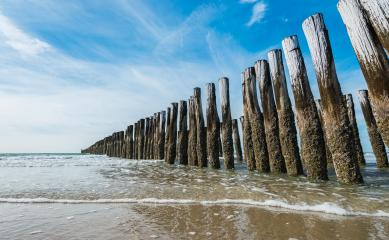 Wave flows around wooden breakwater- Stock Photo or Stock Video of rcfotostock | RC-Photo-Stock