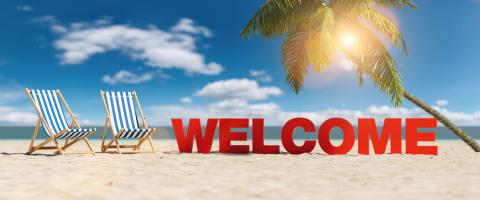 Welcome concept with slogan on the beach with deckchairs, Palm tree and blue sky- Stock Photo or Stock Video of rcfotostock | RC-Photo-Stock
