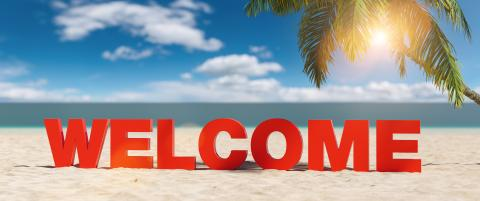 Welcome concept with slogan on the beach with Palm tree and blue sky- Stock Photo or Stock Video of rcfotostock   RC-Photo-Stock