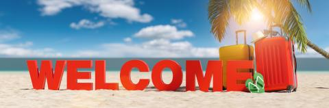 Welcome concept with slogan on the beach with Suitcase, Palm tree, flip-flops and blue sky- Stock Photo or Stock Video of rcfotostock | RC-Photo-Stock
