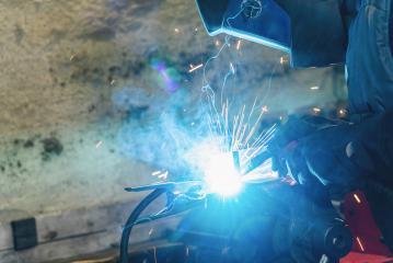 welder is welding metal part in car garage- Stock Photo or Stock Video of rcfotostock | RC-Photo-Stock