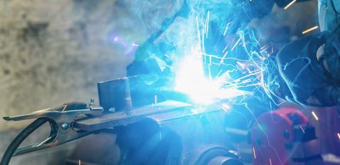 welder welds a metal piece and sparks from welding fly in different directions- Stock Photo or Stock Video of rcfotostock | RC-Photo-Stock