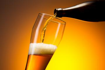wheat beer pouring out of a bottle- Stock Photo or Stock Video of rcfotostock | RC-Photo-Stock