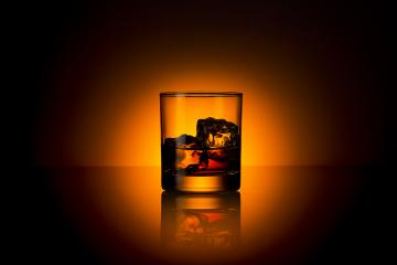 Whiskey glass bourbon with ice cubes rocks and orange sunset dawn summer- Stock Photo or Stock Video of rcfotostock | RC-Photo-Stock