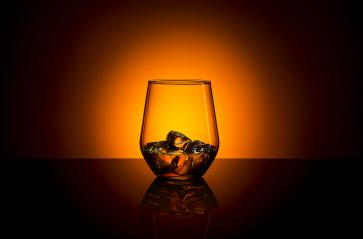 Whiskey glass drink with ice cubes and orange sunset summer : Stock Photo or Stock Video Download rcfotostock photos, images and assets rcfotostock | RC-Photo-Stock.: