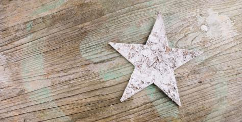 white wooden star on a old rustic wooden board, christmas decoration- Stock Photo or Stock Video of rcfotostock | RC-Photo-Stock