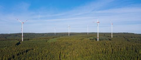 wind farm in the forest - energy production with clean and renewable energy - aerial shot- Stock Photo or Stock Video of rcfotostock   RC-Photo-Stock
