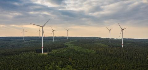 wind farm in the forest at sunset - energy production with clean and renewable energy - aerial shot : Stock Photo or Stock Video Download rcfotostock photos, images and assets rcfotostock | RC-Photo-Stock.: