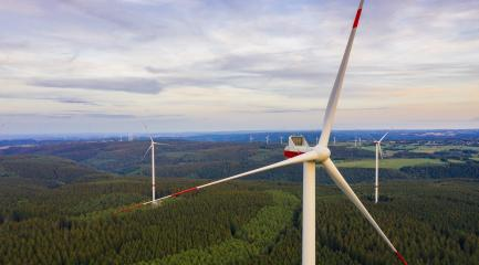wind farm in the forest at sunset - energy production with clean and renewable energy - aerial shot- Stock Photo or Stock Video of rcfotostock | RC-Photo-Stock