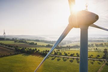 Wind turbine and agricultural fields on a summer day - Energy Production with clean and Renewable Energy - aerial shot- Stock Photo or Stock Video of rcfotostock | RC-Photo-Stock