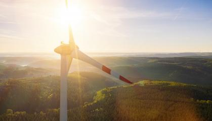 Wind turbine and Landscape on a summer day - Energy Production with clean and Renewable Energy - aerial shot- Stock Photo or Stock Video of rcfotostock | RC-Photo-Stock