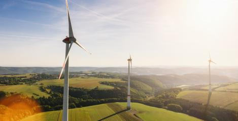 Wind turbine drone shot on a summer day - Energy Production with clean and Renewable Energy - aerial view- Stock Photo or Stock Video of rcfotostock | RC-Photo-Stock