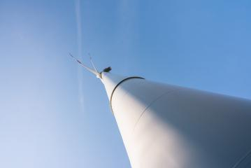 Wind turbine generating electricity with blue sky - energy conservation concept- Stock Photo or Stock Video of rcfotostock | RC-Photo-Stock