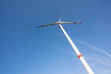 Wind turbine generating electricity with blue sky - energy conservation concept : Stock Photo or Stock Video Download rcfotostock photos, images and assets rcfotostock | RC-Photo-Stock.: