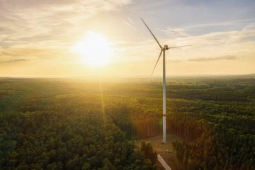 Wind Turbine in the forest at sunset aerial view drone shot - Energy Production with clean and Renewable Energy- Stock Photo or Stock Video of rcfotostock | RC-Photo-Stock