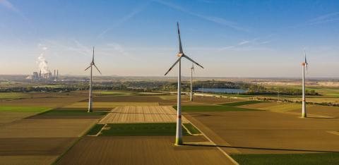 Wind turbine with coal power plant view from drone - environment friendly, renewable energy concept - copyspace for your individual text : Stock Photo or Stock Video Download rcfotostock photos, images and assets rcfotostock | RC-Photo-Stock.: