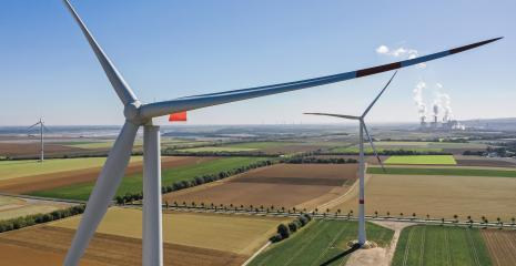 Wind turbine with coal power plant view from drone - Sustainable development, environment friendly, renewable energy concept. : Stock Photo or Stock Video Download rcfotostock photos, images and assets rcfotostock | RC-Photo-Stock.: