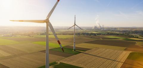 Wind turbine with coal power plant view from drone - Sustainable development, environment friendly, renewable energy concept - copyspace for your individual text : Stock Photo or Stock Video Download rcfotostock photos, images and assets rcfotostock | RC-Photo-Stock.: