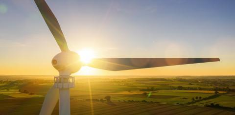Wind turbines and agricultural fields on a summer day - Energy Production with clean and Renewable Energy - aerial shot, analog image style, banner size, copyspace for your individual text.- Stock Photo or Stock Video of rcfotostock   RC-Photo-Stock