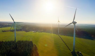 Wind turbines and agricultural fields on a summer day - Energy Production with clean and Renewable Energy - aerial drone shot- Stock Photo or Stock Video of rcfotostock | RC-Photo-Stock