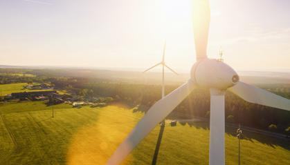 Wind turbines and agricultural fields on a summer day - Energy Production with clean and Renewable Energy - aerial shot, analog image style - Stock Photo or Stock Video of rcfotostock | RC-Photo-Stock