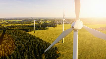 Wind turbines and agricultural fields on a summer day - Energy Production with clean and Renewable Energy - aerial shot, analog image style- Stock Photo or Stock Video of rcfotostock | RC-Photo-Stock