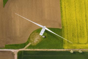 Wind turbines and agricultural fields on a summer day - Energy Production with clean and Renewable Energy - top view shot- Stock Photo or Stock Video of rcfotostock | RC-Photo-Stock