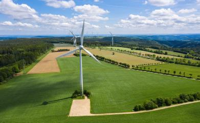 Wind turbines and agricultural fields on a summer day - Energy Production with clean and Renewable Energy - aerial shot- Stock Photo or Stock Video of rcfotostock | RC-Photo-Stock