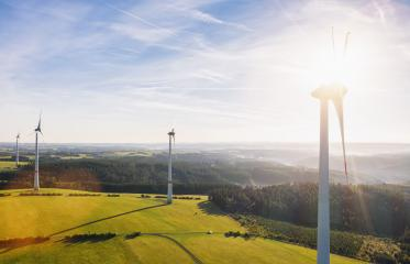Wind turbines farm and Landscape on a summer day - Energy Production with clean and Renewable Energy - aerial drone shot- Stock Photo or Stock Video of rcfotostock | RC-Photo-Stock