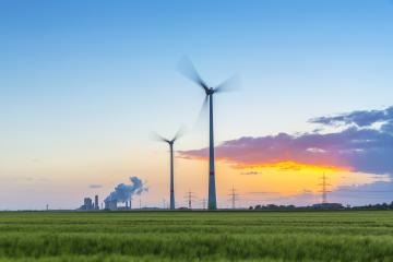Wind turbines with coal-fired plant at sunset : Stock Photo or Stock Video Download rcfotostock photos, images and assets rcfotostock | RC-Photo-Stock.: