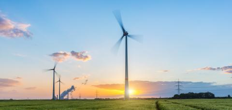 Wind turbines with power plant at sunset with cloudy sky- Stock Photo or Stock Video of rcfotostock | RC-Photo-Stock